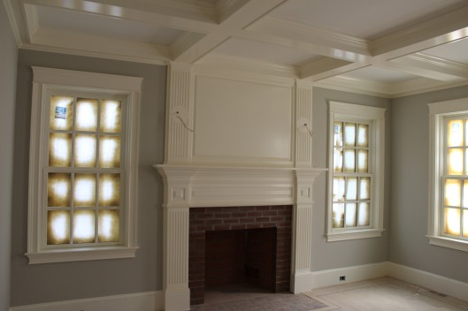 Image of Fireplace mantle with coffered ceiliing