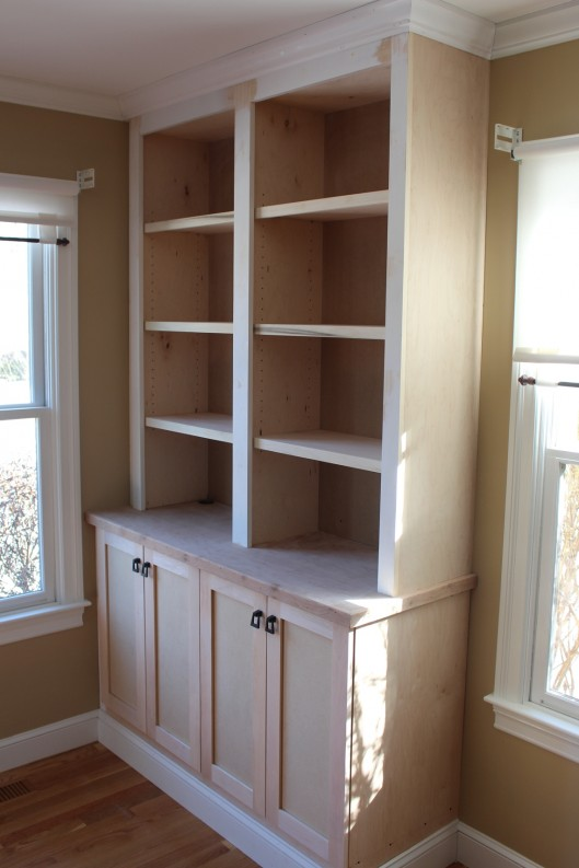 Image of built in bookcase with doors